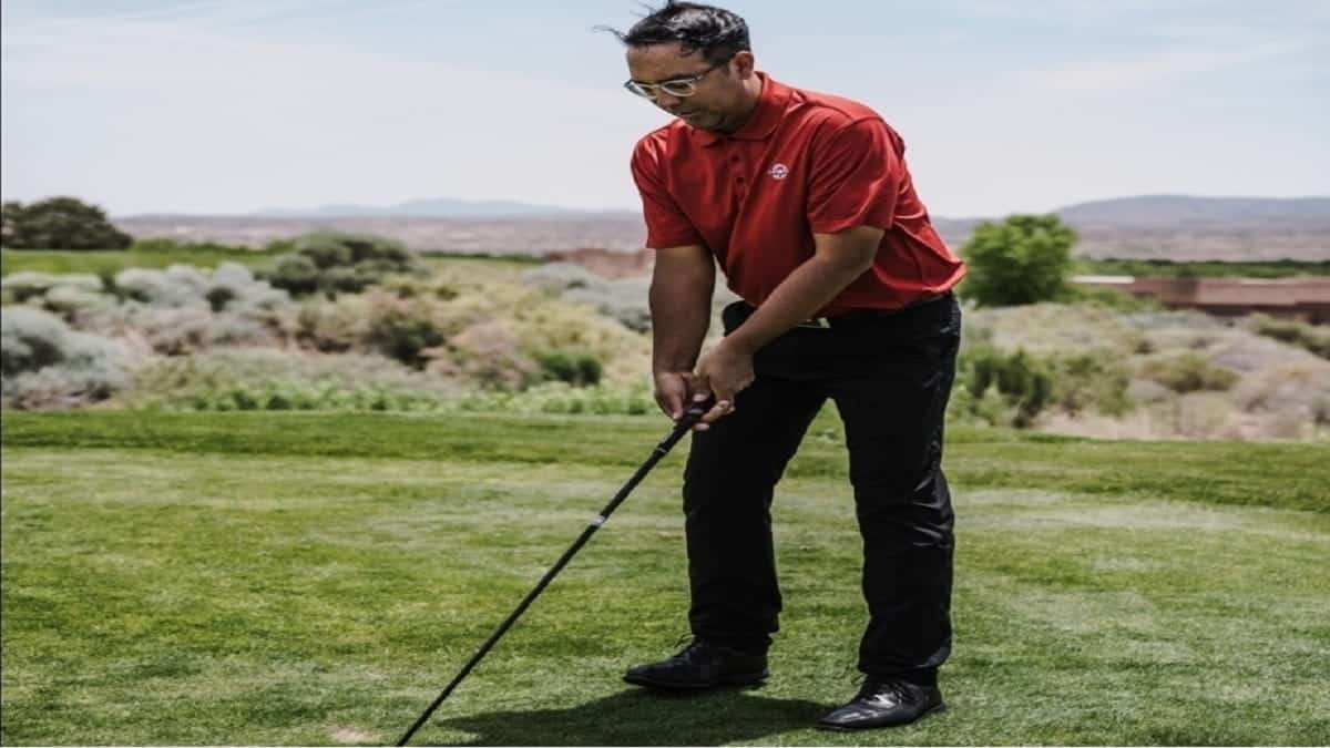 Man using a golf driver