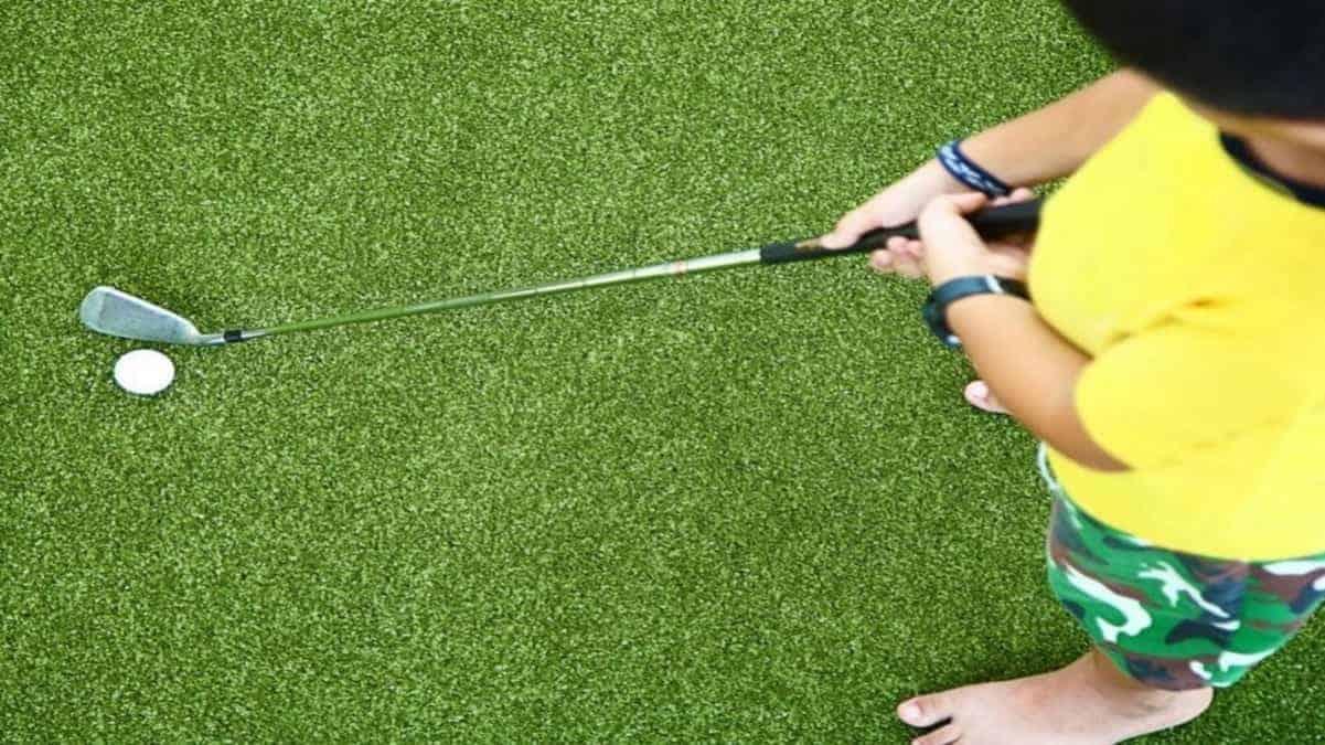 Junior Playing Golf