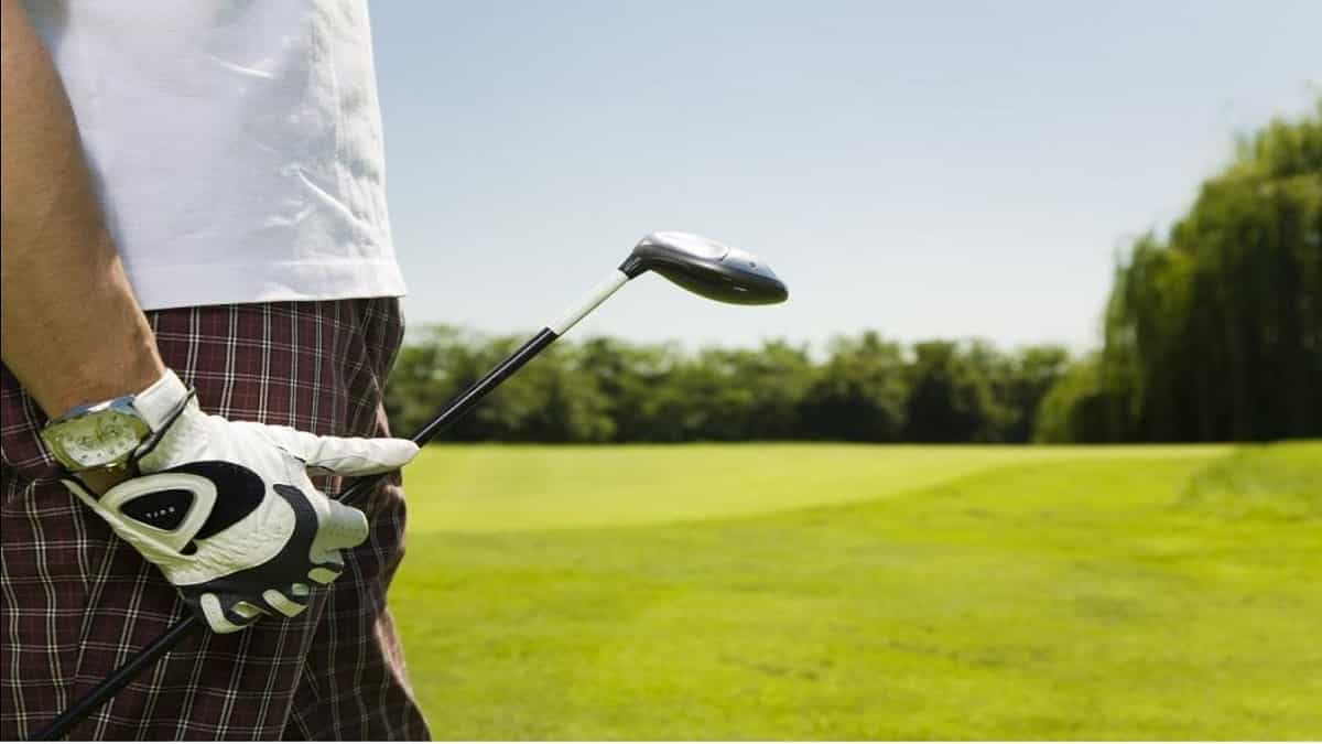 Golfer Standing on Golf Course