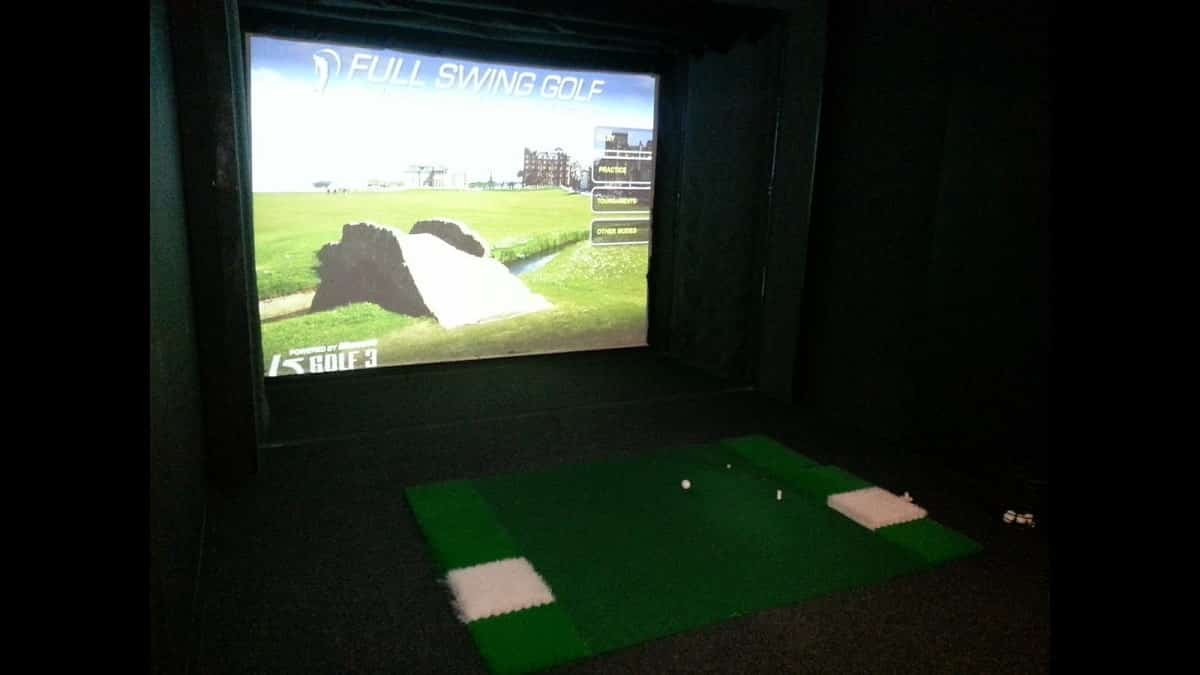 Golf Simulator with Projector in Dark Room