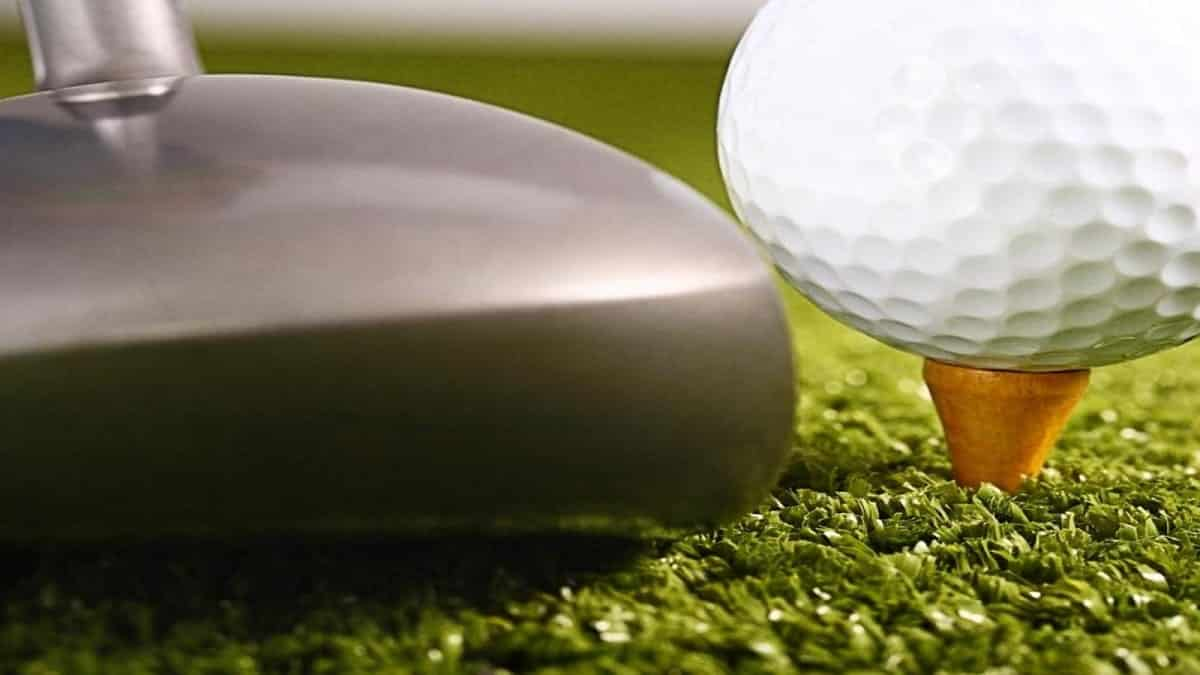 golf club and golf ball close-up