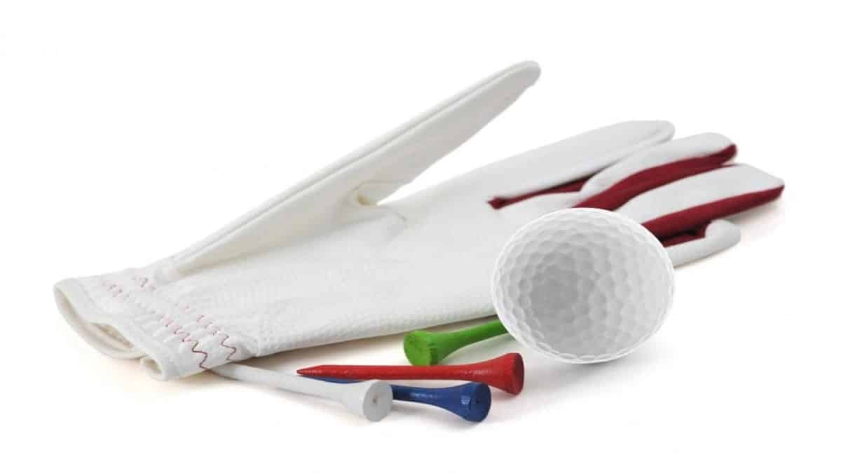 White & maroon golf glove on white background