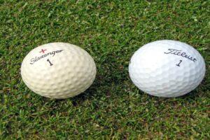 Golf balls on grass
