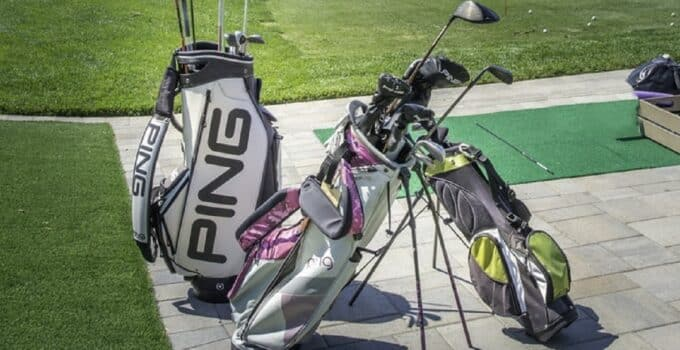 Various standing golf bags.