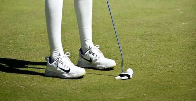Golfer wearing spikeless shoes