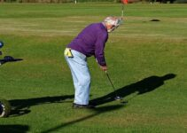 Senior man playing golf