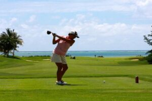 Women playing golf in a golf course